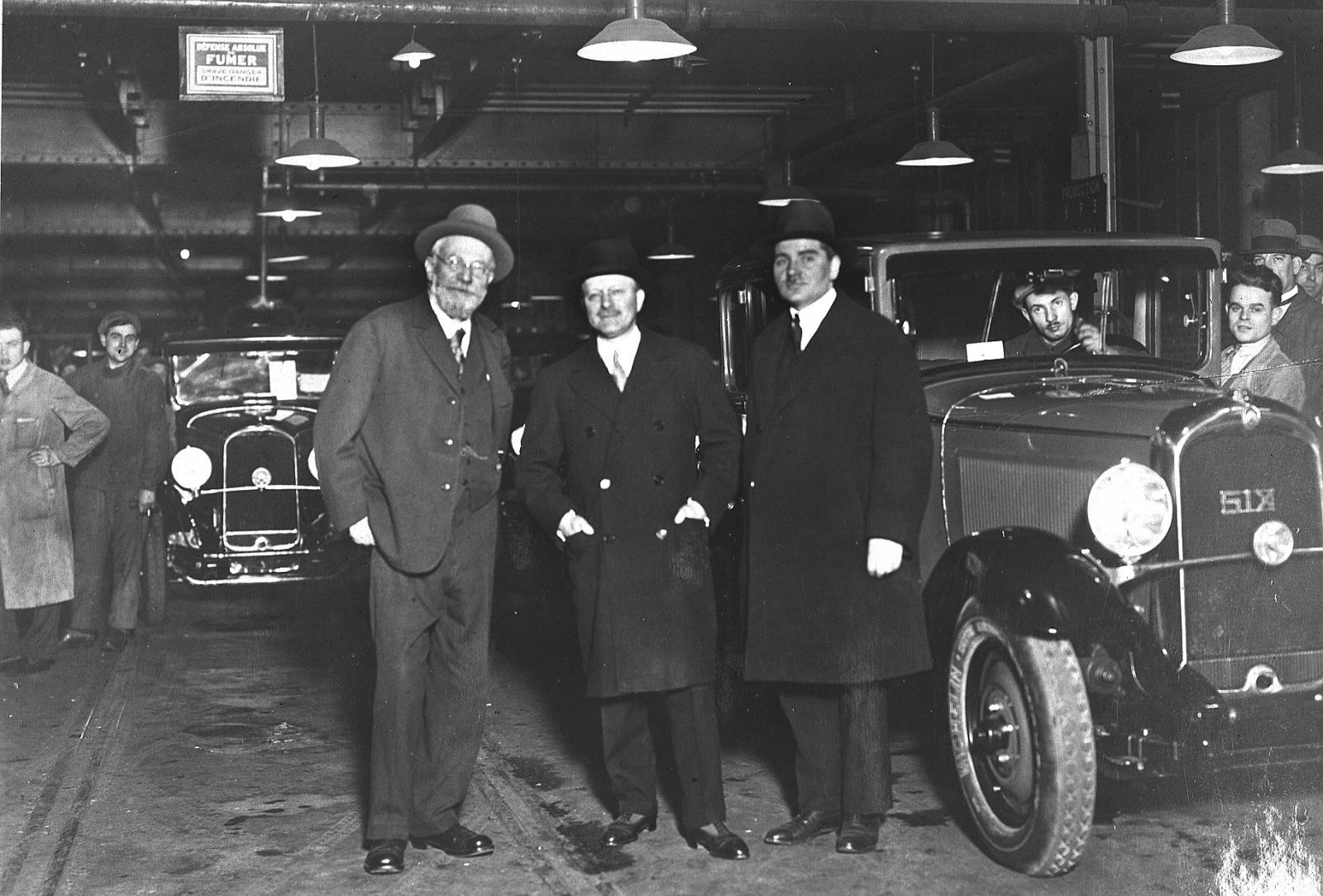 André Citroën et les frères Michelin devant une C6 1931